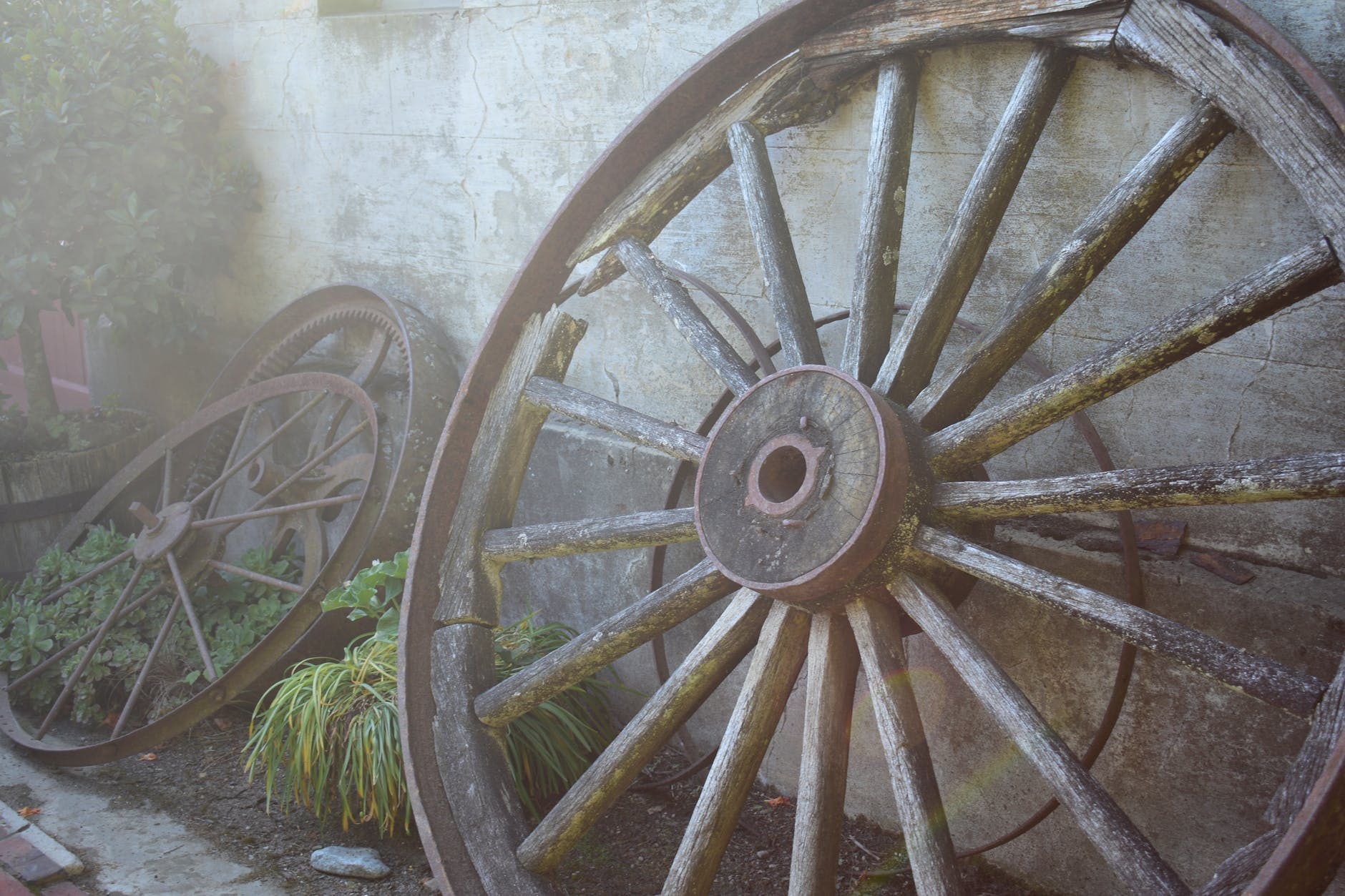 gray multi spoke wheel leaning on wall